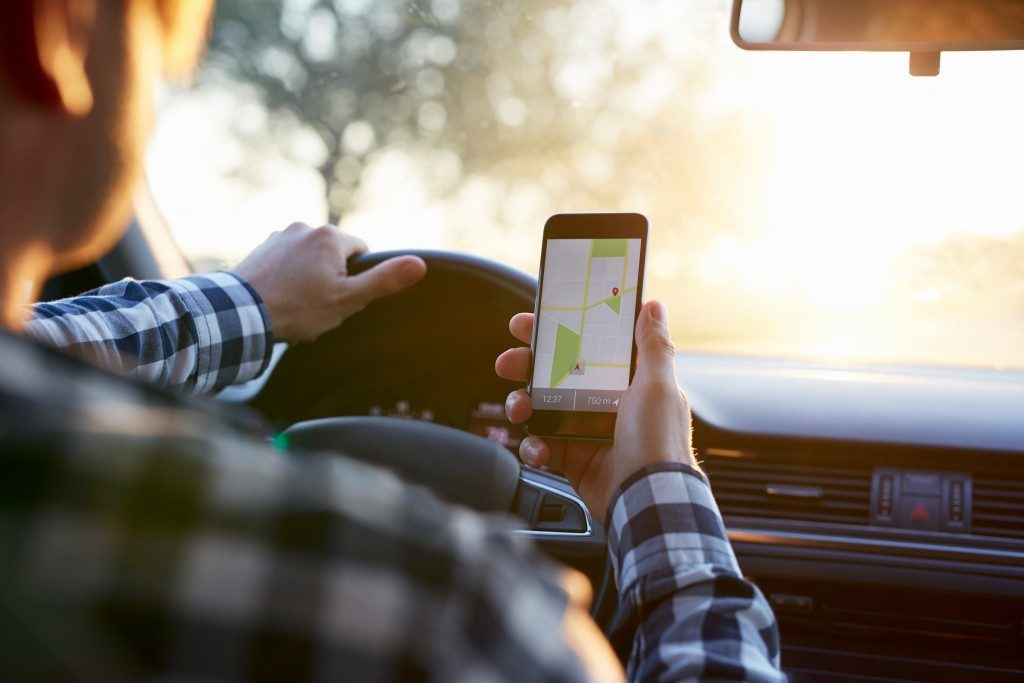 Man using navigation on mobile phone