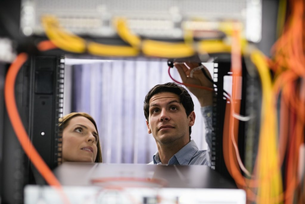 man and woman employee doing system check