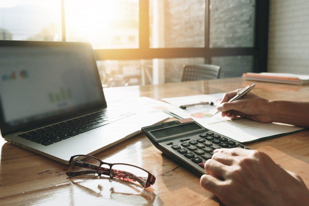 Businessman calculating budget