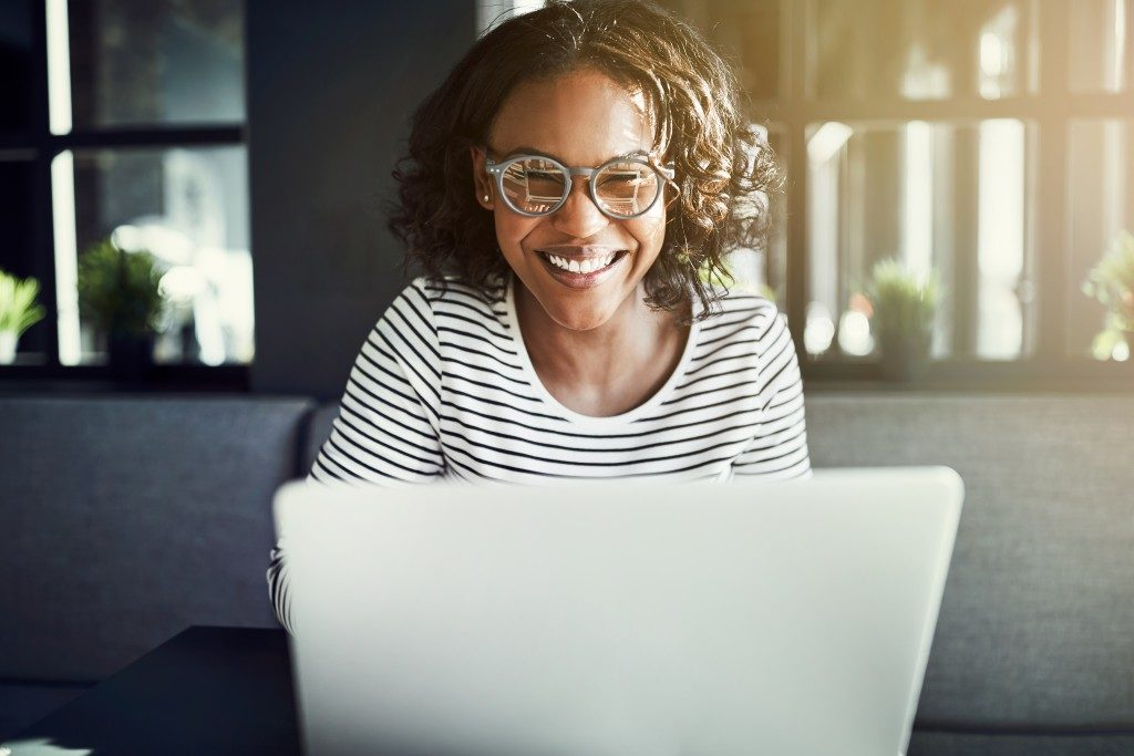 Person smiling at laptop