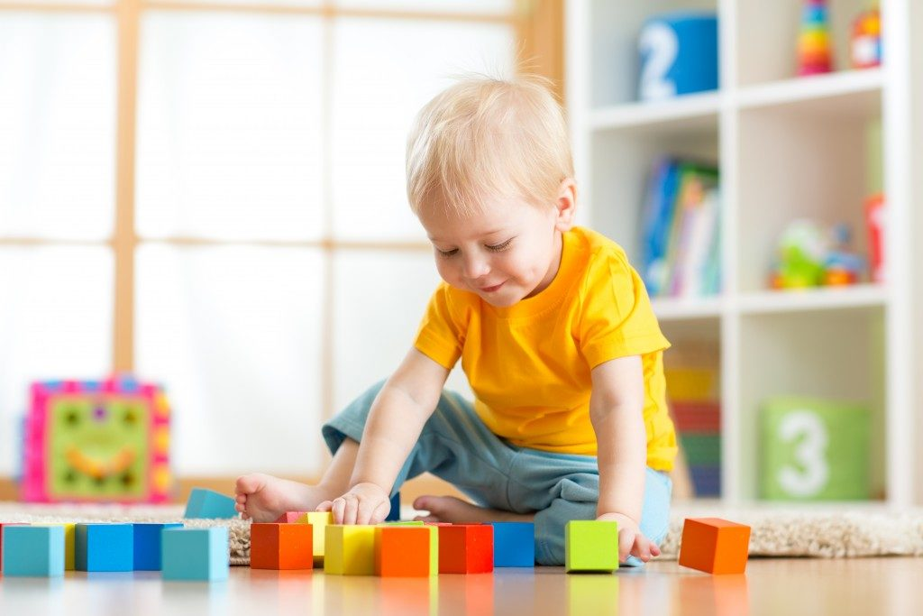 baby playing blocks on the floor
