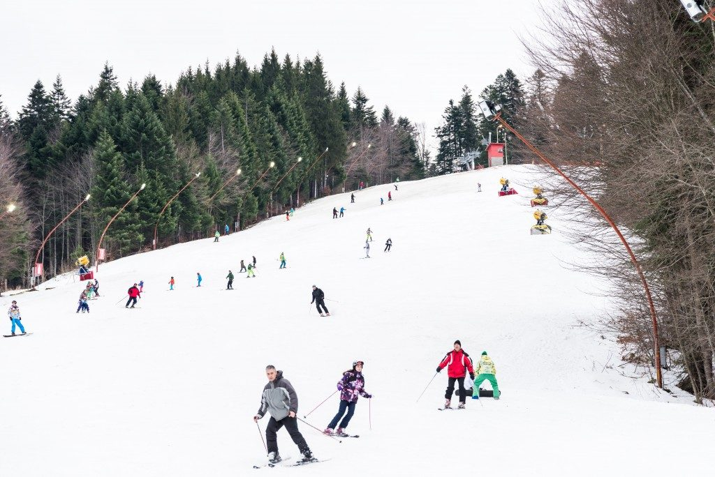 people skiing down the slope