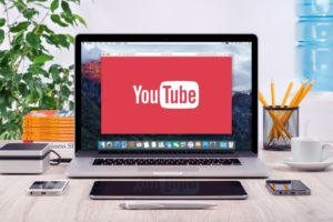 Youtube logo shown in the laptop