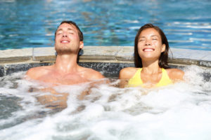 Male and female in a hot tub