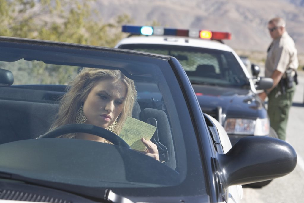 woman being issued a ticket