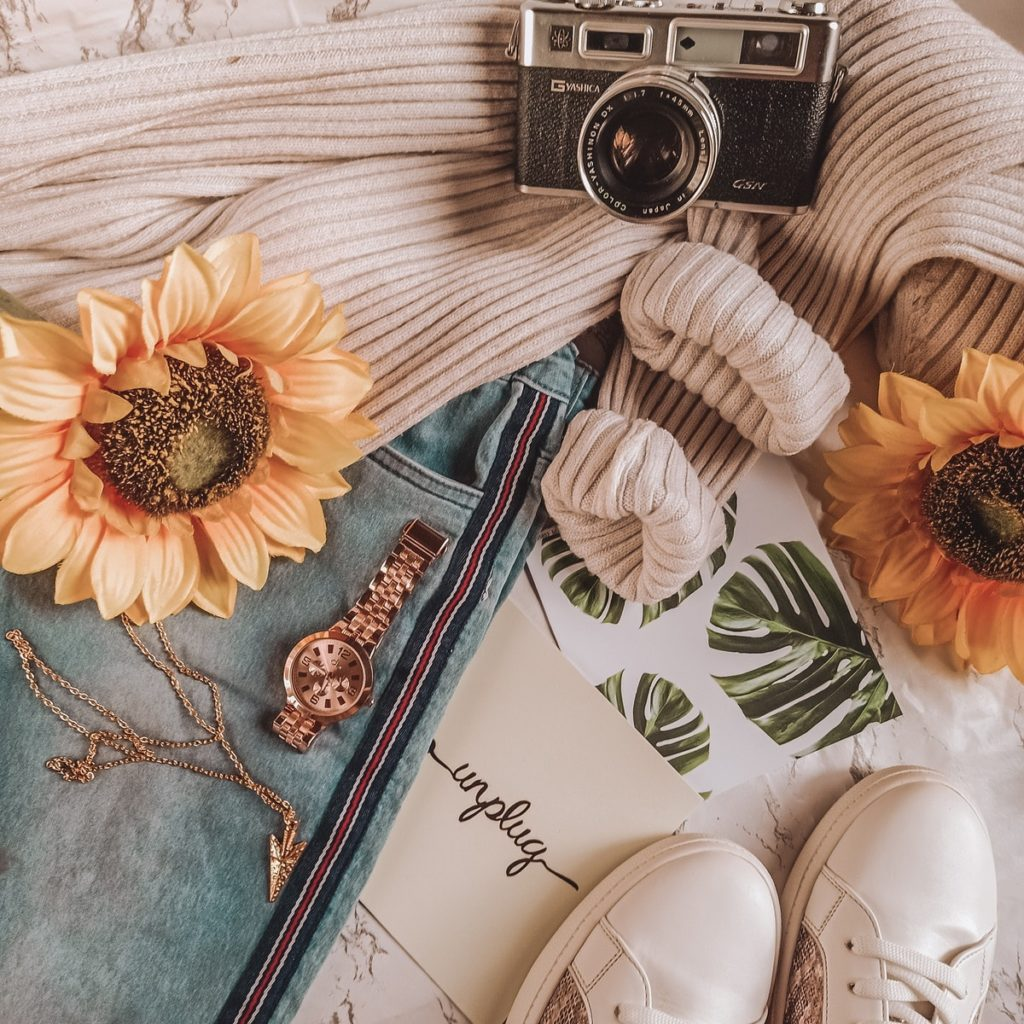 camera, clothes and sunflowers